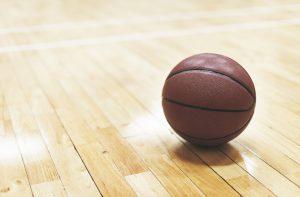 Basketball on wooden floor court